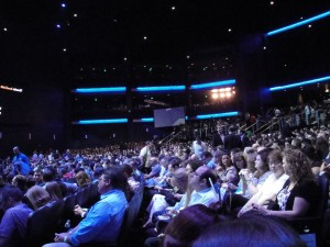 Press, exhibitors and attendees watching Nintendo's 2011 E3 presentation.